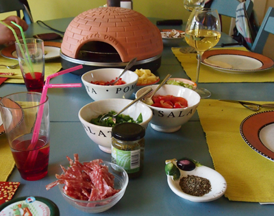 pizzarette voor minipizza bakken aan tafel. Net als gourmetten, maar dan op z'n Italiaans!